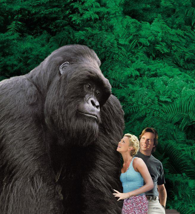 Jill (Charlize Theron, l.) und der US-Wissenschaftler Gregg O'Hara (Bill Paxton, r.) wollen Gorilla Joe vor Wilderern in Sicherheit bringen. Nach L.... - Bildquelle: Ron Batzdorff Disney Enterprises Inc.