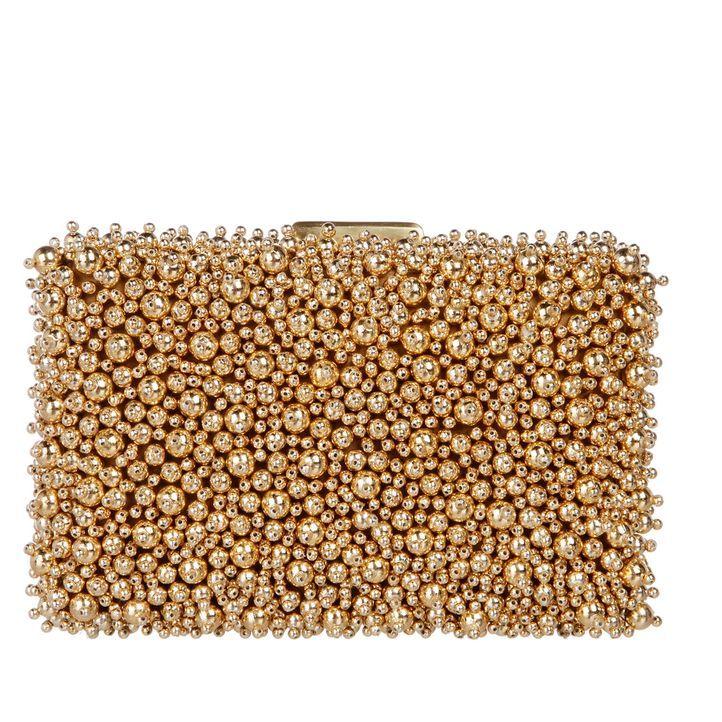 Die perfekte Tasche in gold - Bildquelle: dresscoded.com