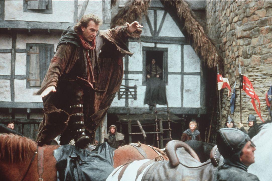 Die Abwesenheit des Königs Richard Löwenherz nutzt der Sheriff von Nottingham, um einen blutigen Kampf gegen das eigene Volk zu führen. Robin (Ke... - Bildquelle: WARNER BROS.