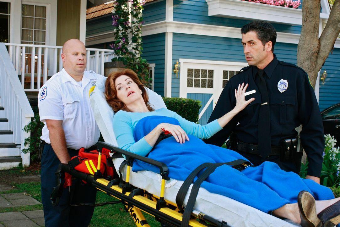 Um sich an Susan und Mike zu rächen, behauptet Katherine (Dana Delany, M.), dass Mike sie niedergestochen habe ... - Bildquelle: ABC Studios