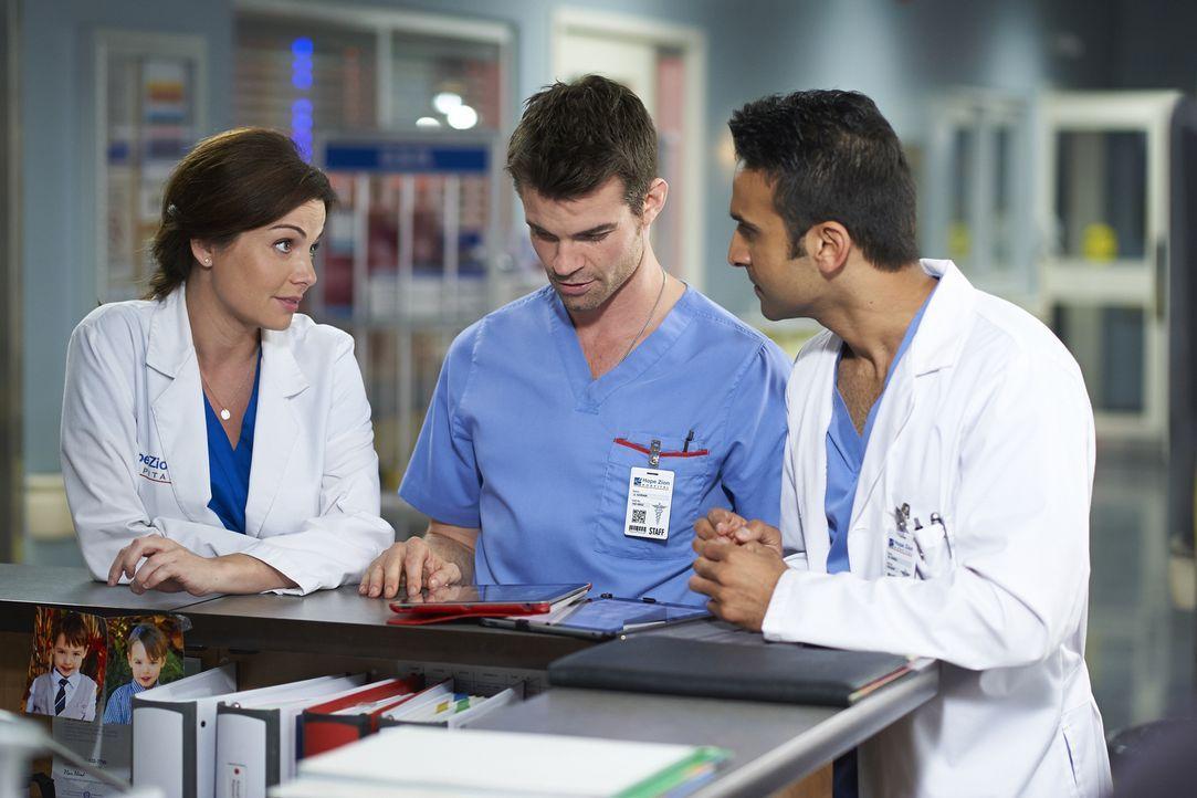 Alex (Erica Durance, l.), Joel (Daniel Gillies, M.) und Dr. Hamza (Huse Madhavji, r.) kümmern sich alle um eine Patientin, nachdem kein Befund wirkl... - Bildquelle: Ken Woroner 2014 Hope Zee Three Inc.