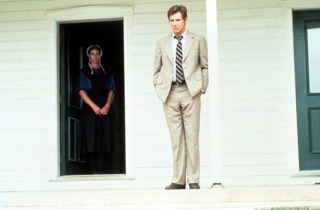 Eine Liebe ohne Chance: Bei den Ermittlungen kommen sich Polizeidetektiv John Book (Harrison Ford, r.) und Rachel (Kelly McGillis, l.) immer näher.... - Bildquelle: Paramount Pictures
