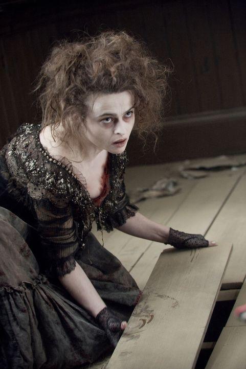 Mrs. Lovett (Helena Bonham Carter) entwickelt eine ausgeprägte Leidenschaft für diabolische Fleischpasteten ... - Bildquelle: Warner Bros.