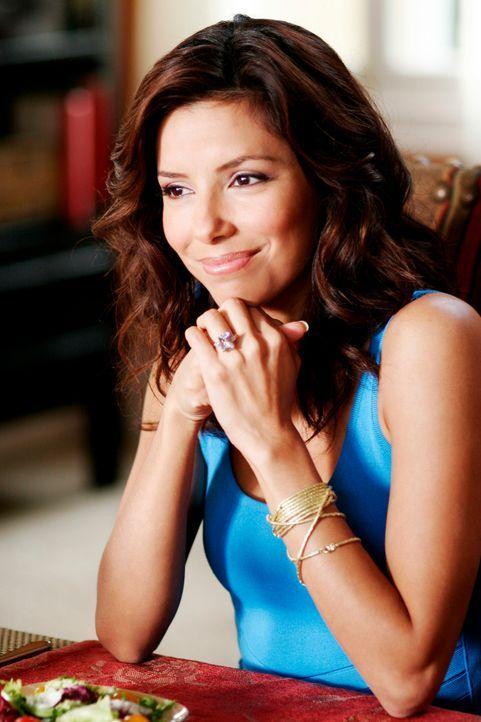 Gabrielle (Eva Longoria) ist überrascht, als Carlos plötzlich nach Hause kommt. Er wird vorzeitig aus dem Gefängnis entlassen, da er sich einer kath... - Bildquelle: 2005 Touchstone Television  All Rights Reserved