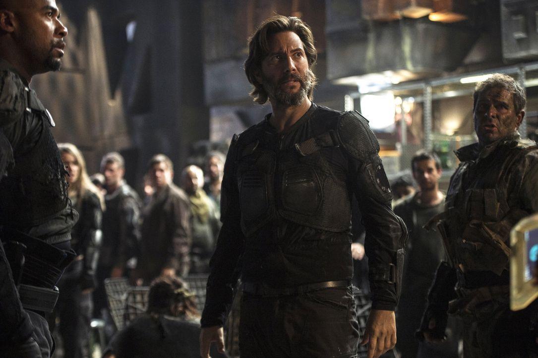 Ist es bereits zu spät, als Kane (Henry Ian Cusick) erkennt, dass das anfänglich freudige Wiedersehen mit anderen Überlebenden aus dem Ark, sich nac... - Bildquelle: 2014 Warner Brothers