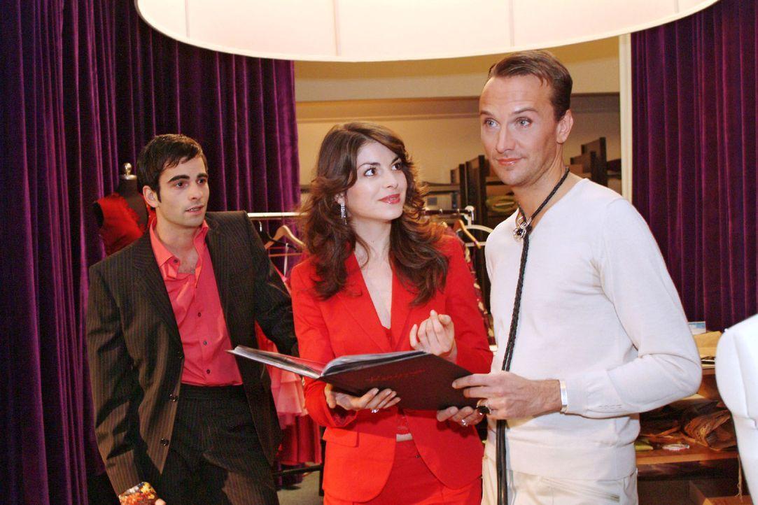 Mariella (Bianca Hein, M.) ignoriert David (Mathis Künzler, l.) demonstrativ, als dieser zu ihrer Besprechung mit Hugo (Hubertus Regout, r.) stößt. - Bildquelle: Sat.1