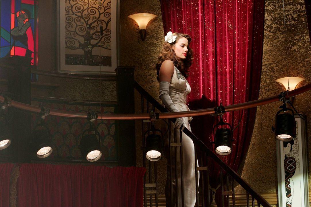 Während Chloe im realen Smallville den Angriff auf Lana aufklärt, hat Lois (Erica Durance) in der Traumversion eine Affäre mit Lex ... - Bildquelle: Warner Bros.