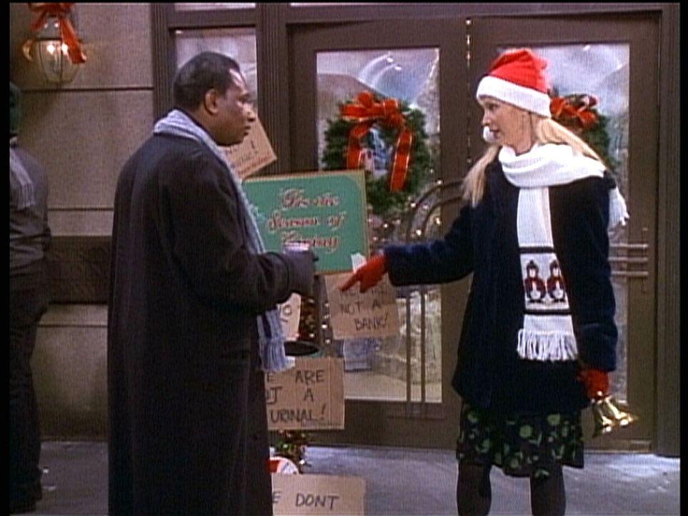 Phoebe (Lisa Kudrow, r.) sammelt vor Weihnachten Spenden. - Bildquelle: TM+  2000 WARNER BROS.