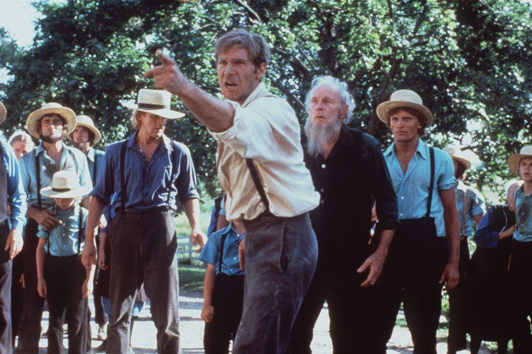 Polizeidetektiv John Book (Harrison Ford, vorne) ist nicht so friedfertig wie die Amish-Jünger ... - Bildquelle: Paramount Pictures